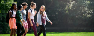 group of students walking on campus featured