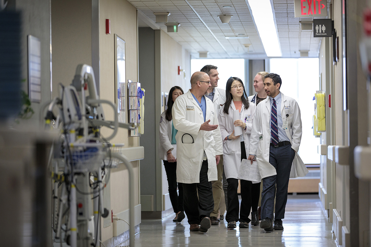 School of Medicine medical team walking and talking in a hospital